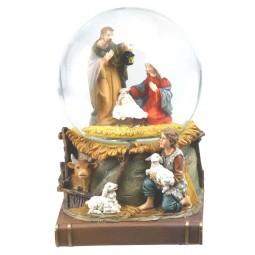Snow globe nativity scene on book