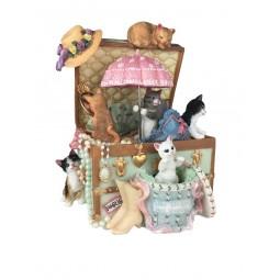 Carillon gatti in un cassone