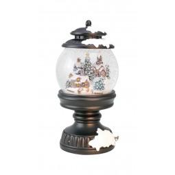 Snowglobe in a lantern shows a Christmas town