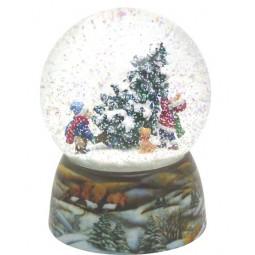 Snowglobe, porcelain base, children carry a Christmas tree