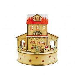 Casa di Natale in legno, illuminata