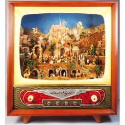Televisore grande con scena di presepe