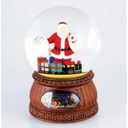 Sfera con Babbo Natale, lista dei desideri e regali