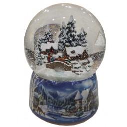 Palla di neve in porcellana con una scena di case invernali