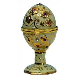 Uovo verde con pietre preziose