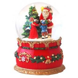 Palla di neve Babbo Natale con i bambini nel bosco